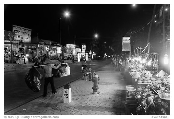 Stalls on main street at night. Mui Ne, Vietnam (black and white)