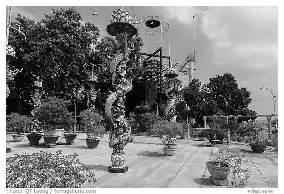 Sculptures of Chinese dragons at Temple of the Coconut Monk. My Tho, Vietnam (black and white)