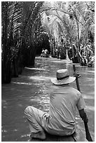 Padding in mangrove-lined narrow waterway, Phoenix Island. My Tho, Vietnam ( black and white)