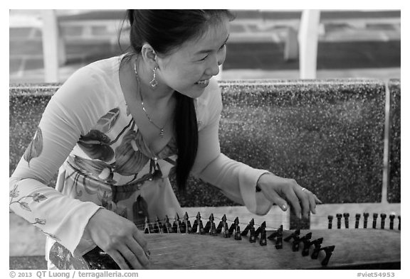 Musician with instrument. My Tho, Vietnam (black and white)