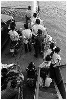 People on ferry seen from above. Mekong Delta, Vietnam ( black and white)
