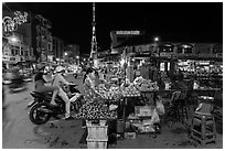 Street market and telecomunication tower at night. Tra Vinh, Vietnam (black and white)