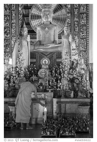 Monk lighting incense at  Ang Pagoda altar. Tra Vinh, Vietnam (black and white)