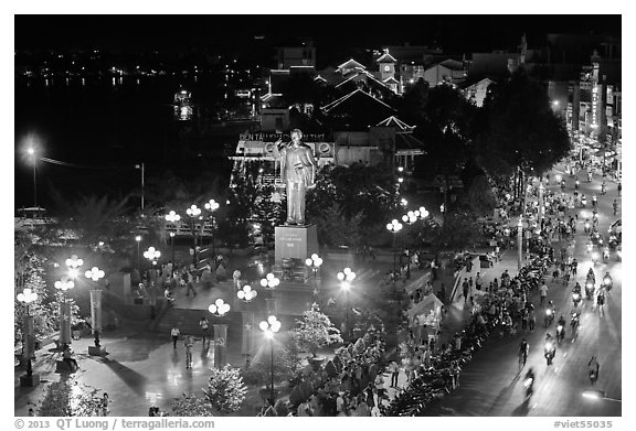 Mekong River, Ho Chi Minh statue, and street at night. Can Tho, Vietnam (black and white)