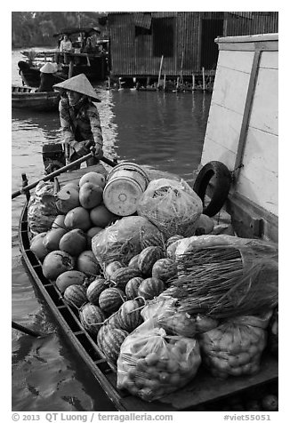 Woman paddles boat fully loaded with produce, Phung Diem. Can Tho, Vietnam (black and white)