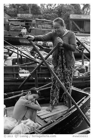 Woman and girl, Phung Diem floating market. Can Tho, Vietnam (black and white)