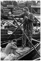 Woman and girl, Phung Diem floating market. Can Tho, Vietnam ( black and white)