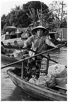 Woman using the x-shape paddles. Can Tho, Vietnam ( black and white)