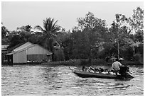 Schoolchildren on boat commute. Can Tho, Vietnam ( black and white)