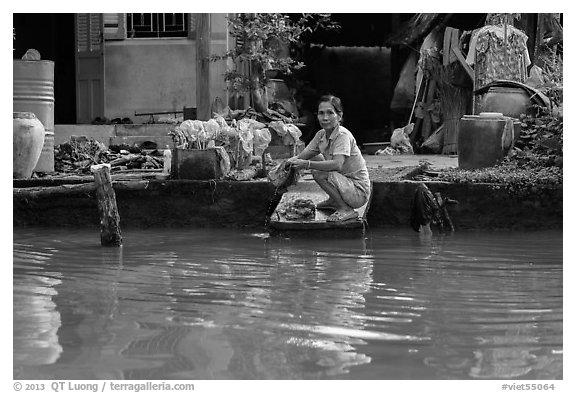 Woman laudering at the river. Can Tho, Vietnam (black and white)