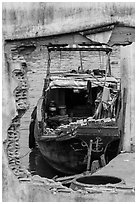 Boat loaded with bricks seen from brick wall opening. Can Tho, Vietnam (black and white)