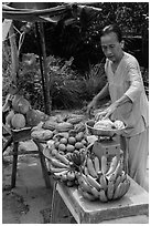 Woman selling fruit from roadside stand. Can Tho, Vietnam (black and white)