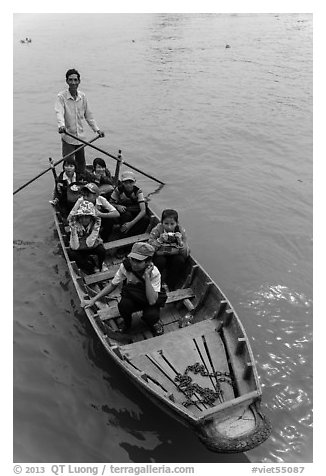Schoolchildren rowed by parent. Can Tho, Vietnam (black and white)