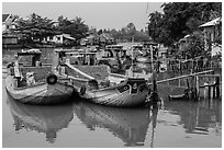 Boats loaded with bricks. Can Tho, Vietnam (black and white)