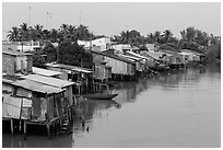 Riverside houses on stilts. Mekong Delta, Vietnam ( black and white)
