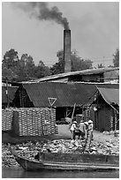 Workers moving bricks in brick factory. Sa Dec, Vietnam (black and white)