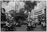 Motorcycle traffic near University of Medicine. Cholon, Ho Chi Minh City, Vietnam ( black and white)