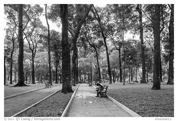 Couple looking at mobile phone, April 30 Park. Ho Chi Minh City, Vietnam (black and white)
