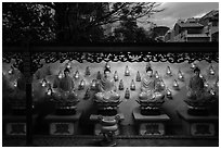 Buddha images at dusk, Viet Nam Quoc Tu pagoda. Ho Chi Minh City, Vietnam ( black and white)