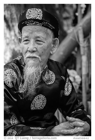 Elder in traditional costume. Ho Chi Minh City, Vietnam (black and white)