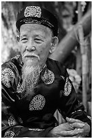 Elder in traditional costume. Ho Chi Minh City, Vietnam ( black and white)