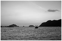 Boats and Con Son Bay at sunset. Con Dao Islands, Vietnam ( black and white)
