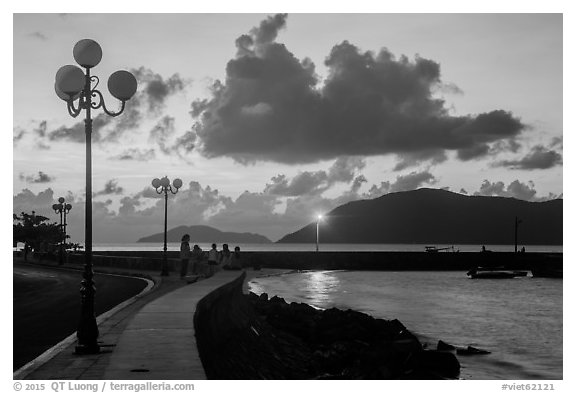 Lamps and Con Son seafront before sunrise. Con Dao Islands, Vietnam (black and white)