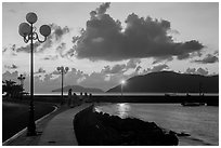 Lamps and Con Son seafront before sunrise. Con Dao Islands, Vietnam ( black and white)