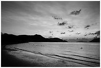 Con Son Beach with people in water before sunrise. Con Dao Islands, Vietnam ( black and white)