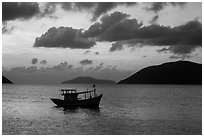 Fishing boat and Con Son Bay, sunrise. Con Dao Islands, Vietnam ( black and white)
