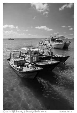 Fishing boats floating on clear water, Con Son. Con Dao Islands, Vietnam (black and white)