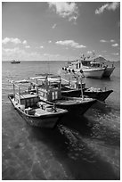 Fishing boats floating on clear water, Con Son. Con Dao Islands, Vietnam ( black and white)
