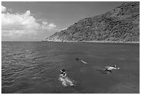 Snorklers near Bay Canh Island, Con Dao National Park. Con Dao Islands, Vietnam ( black and white)