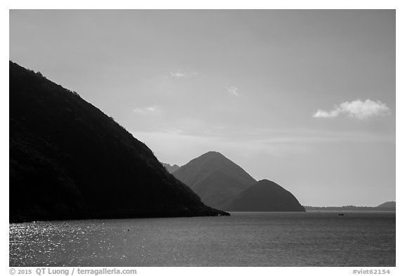 Hills plunging in sea, Bay Canh Island, Con Dao National Park. Con Dao Islands, Vietnam (black and white)