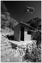 Entrance booth with Vietnam flag, Bay Canh Island, Con Dao National Park. Con Dao Islands, Vietnam ( black and white)