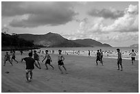 Men play soccer on beach, Con Son. Con Dao Islands, Vietnam ( black and white)