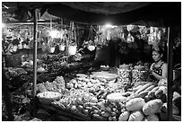 Vegetable seller at night, Con Dao Market, Con Son. Con Dao Islands, Vietnam ( black and white)