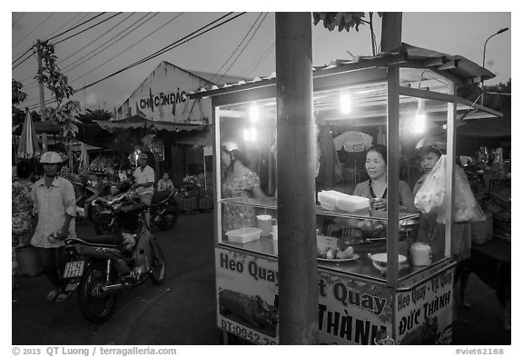 Food vendor at dusk, Con Dao Market, Con Son. Con Dao Islands, Vietnam (black and white)