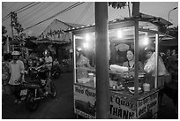 Food vendor at dusk, Con Dao Market, Con Son. Con Dao Islands, Vietnam ( black and white)