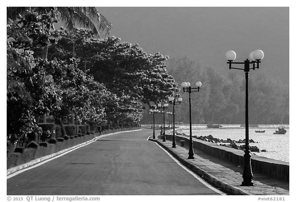 Deserted seafront promenade lined up with lamps, Con Son. Con Dao Islands, Vietnam (black and white)