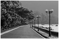 Deserted seafront promenade lined up with lamps, Con Son. Con Dao Islands, Vietnam ( black and white)