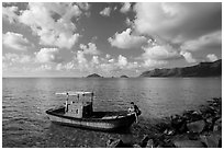 Fisherman climbing on boat, Con Son. Con Dao Islands, Vietnam ( black and white)