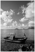 Fisherman lifting anchor from boat, Con Son. Con Dao Islands, Vietnam ( black and white)