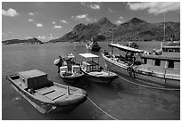 Fishing boats and Ba Island, Ben Dam. Con Dao Islands, Vietnam ( black and white)