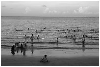 Beachgoers at sunset, Con Son. Con Dao Islands, Vietnam ( black and white)