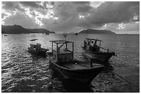 Fishing boats at sunrise, Con Son harbor. Con Dao Islands, Vietnam ( black and white)