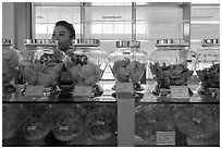 Eddible birds nest and vendor. Con Dao Islands, Vietnam ( black and white)