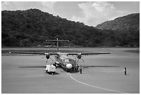 Turboprop plane and airport. Con Dao Islands, Vietnam ( black and white)