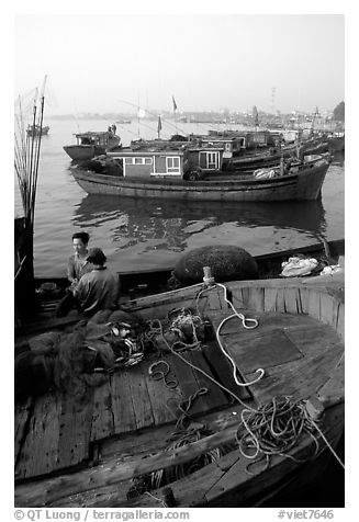 Fisherman relax in a boat, Dong Hoi. Vietnam