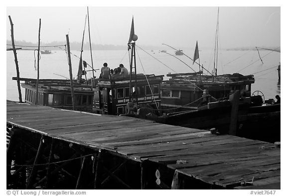Pier and fishing boats, Nhat Le River, Dong Hoi. Vietnam (black and white)